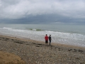 My sons standing on Omaha Beach near the American Cemetery. Cold, rainy day in early July. Weather similar to D-Day
