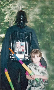 Darth is really her father!  What weapons my daughters grew up playing with!