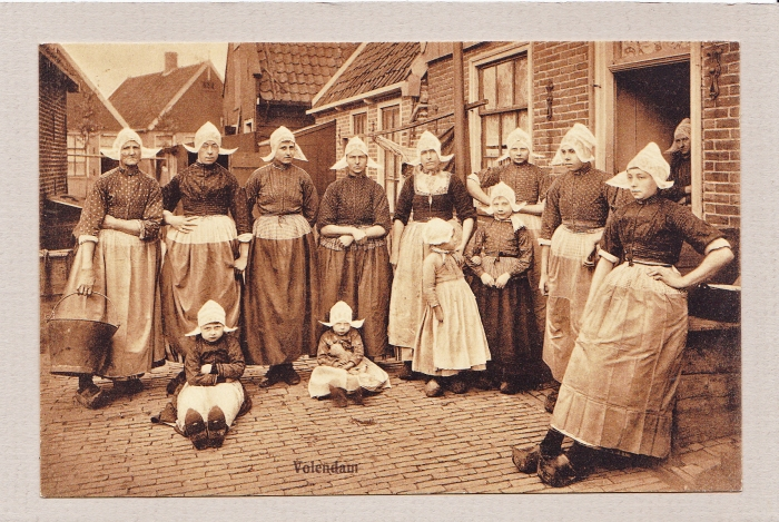 An old postcard of Holland.  I can't picture actually walking in wooden shoes all day.  These women seem to not be there for the tourist trade, but the card is from around 1920