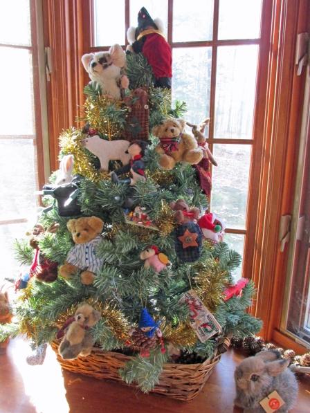 This year's tree, Napoleon still proudly decorates.