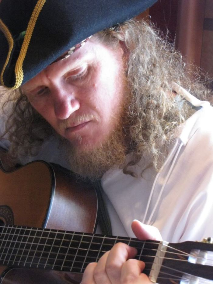 To honor Naomi's soon to be cruising adventure on the high seas, I'm sharing a photograph from a cruise we took together.  One wonderful member of our group, from Australia, dressed as a pirate the entire trip.  He was a truly wonderful, and musically talented, travel companion.