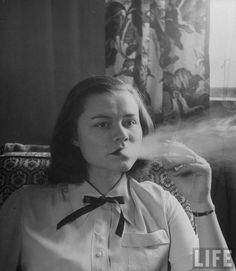 LIFE magazine photograph of a smoking gym teacher, at least this is the the teachers lounge.
