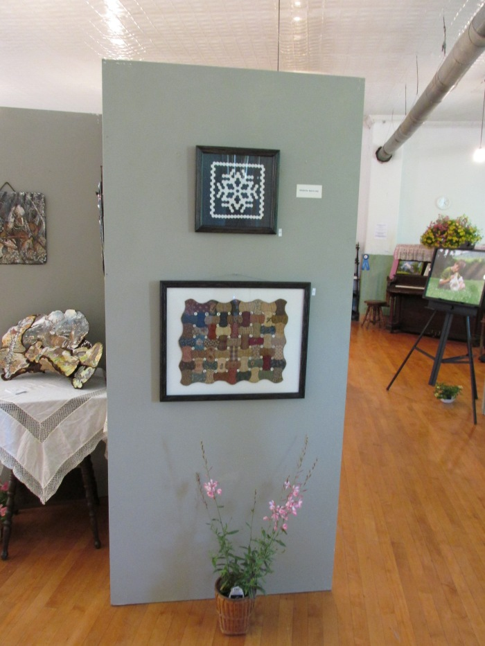 My two small miniature quilts framed as you walk in.  If you frame a miniature it's a great way to display it.