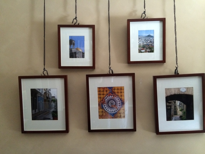 Photo prints from travels. Hanger system from Pottery Barn.