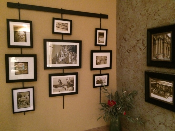 Travel photos printed in sepia tones. Arranged over my bathtub (hanger system from Pottery Barn)