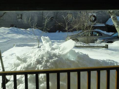 Snow that fell off a one story metal roof.  Photo by DW Brooks
